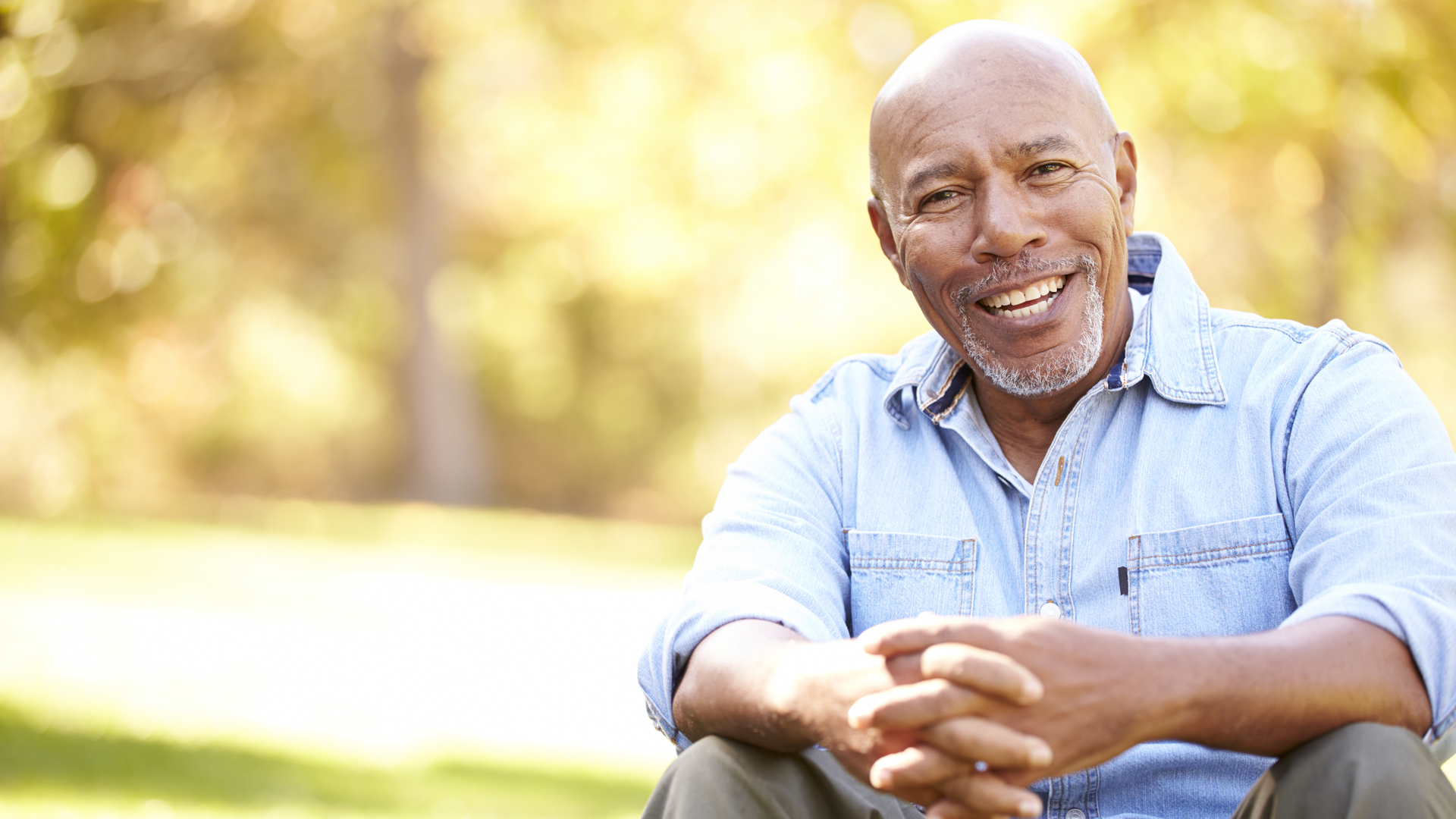 Image of a man seated with hands clasped. To ensure optimal use and comfort, always discuss your coude catheter use with your doctor.