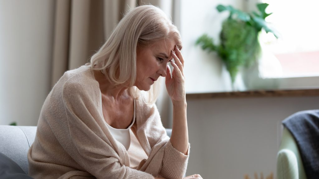 Woman shown experiencing pain or discomfort. Why does a catheter hurt? Learn more about why this can happen and how to reduce or relieve catheter pain.