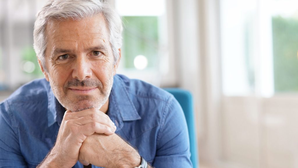 Image showing a man sitting down. A catheter kit may help simplify your cathing process.