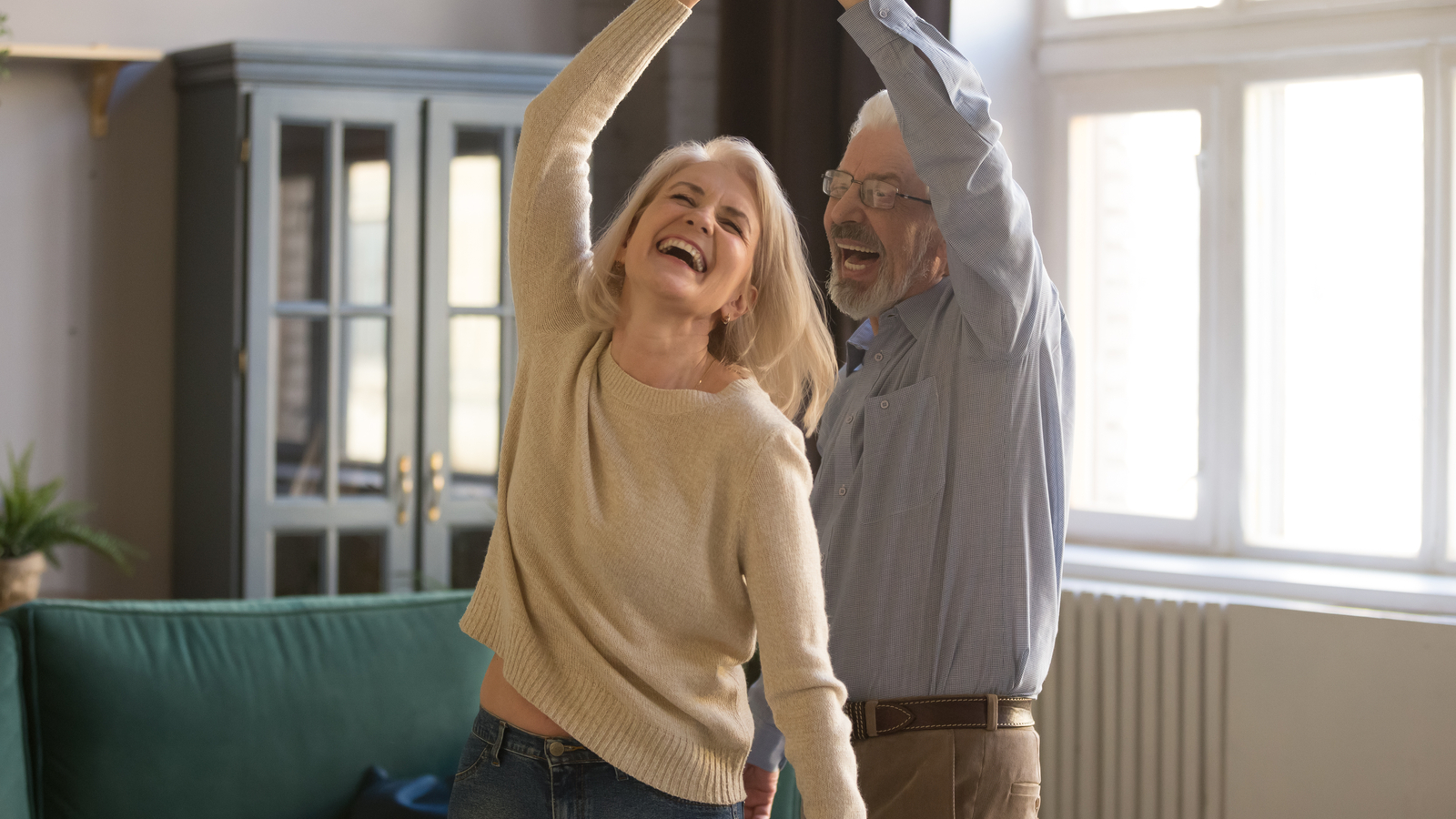 Man and woman dancing. The benefits of coudé catheters are important for many catheter users.